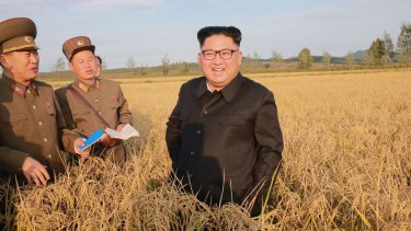 North Korean leader Kim Jong-un, centre, at a farm in North Korea which has historically relied on support from China and Russia.