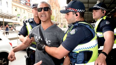 A man claiming he was at one point homeless yelled at the homeless at Flinders Street Station. The police took him away.