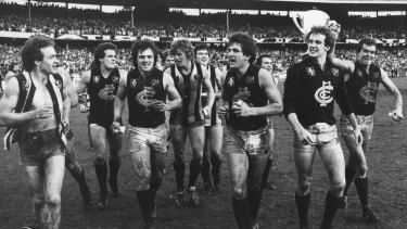 Jubilant Carlton players run a lap of honour after winning the 1979 grand final against Collingwood.
