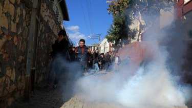 Riot police use teargas to push back pro-Kurdish politicians as security forces clash with Kurdistan Workers' Party, or PKK.