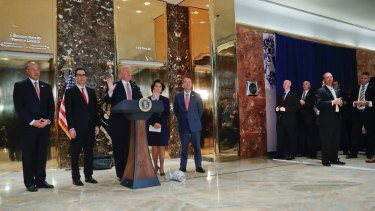 President Donald Trump speaks to the media in the lobby of Trump Tower.