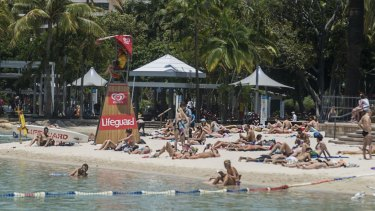 Scorcher: Hundreds of tourists and Brisbane locals spend their G20 public holiday at Streets Beach on Brisbane's South Bank.