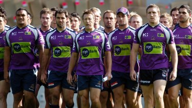 Purple pain: Storm players and coach Craig Bellamy make their defiant walk to waiting media after the scandal broke.