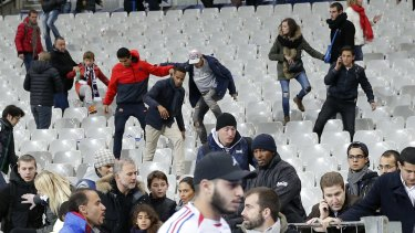 Soccer fans move towads the grounds at the Stade de France after explosions were heard during the friendly match between France and Germany.
