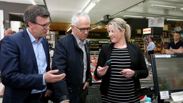Minister for Human Services Alan Tudge and Prime Minister Malcolm Turnbull are shown the cashless debit card in use.