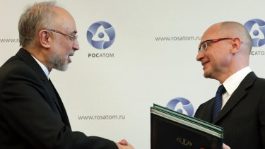 Sergei Kiriyenko (right), head of the Russian state nuclear monopoly Rosatom, and head of Iran's Atomic Energy Organisation Ali Akbar Salehi shake hands during a signing ceremony in Moscow.