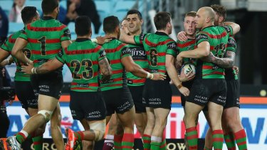 Nice work: Aaron Gray, ball in hand, of the Rabbitohs celebrates with teammates after scoring.