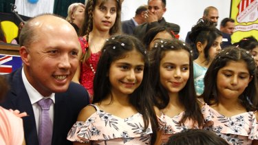 Dutton with Dima Hamkna, 10, Natalie Mirza, 10 and Cassandra Mirza, 9, at Wagga Wagga.