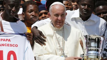 Pope Francis with migrants in St Peter's Square in June 2016.