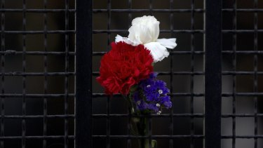 Flowers in the colours of the French flag are displayed on the gate of the French Embassy in Madrid, Spain, on Saturday.