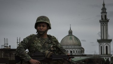 A soldier walking past a mosque in Marawi, southern Philippines.