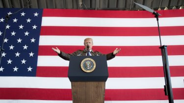 President Donald Trump speaks at a hanger rally at Yokota Air Base in Japan on Sunday.