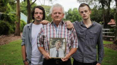 Disappointed: Michael Christie, with his sons Peter and John.
