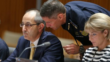 Secretary of the Department of Immigration and Border Protection Michael Pezzullo and Australian Border Force Commissioner Roman Quaedvlieg in discussion during estimates.