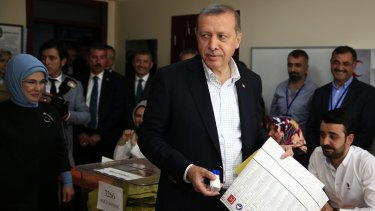 Turkey's President Recep Tayyip Erdogan, accompanied by his wife, Emine, at a polling station in Istanbul, Turkey, will be disappointed with the results of the election.