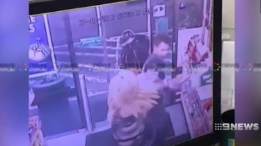 A screenshot from the CCTV inside the 7-Eleven at Enmore.