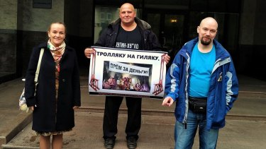 Diana Retsinka and other Russian activists protesting over the activities of so-called troll farms in St Petersburg on October 2.