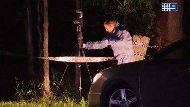 Police investigate the scene of an alleged murder at Delaneys Creek, north of Brisbane.