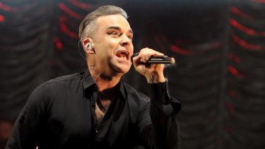 Robbie Williams leads the charity single for victims of the Grenfell fire.