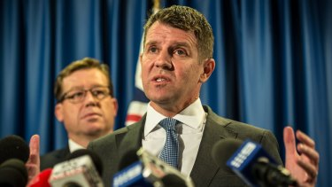 NSW Premier Mike Baird and former deputy premier Troy Grant were stunned by angry and economically fearful voters in Orange.