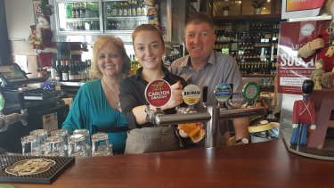 Nicola Farrell (left), Jimmy Queally (right) and their daughter Caoimhe of Balmain's Riverview Hotel.