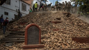 Volunteers and emergency workers search for bodies buried under the debris of one of the temples at Basantapur Durbar Square in Kathmandu, Nepal.