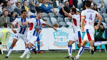 Golden touch: Roy O'Donovan celebrates a first-half goal.