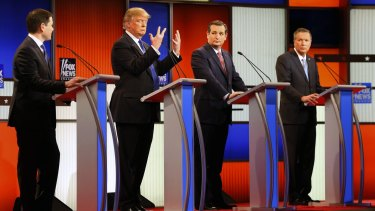 Republican presidential candidate Donald Trump, second from left, shows his hands during Thursday's Republican debate while Marco Rubio (left), Ted Cruz and John Kasich look on.
