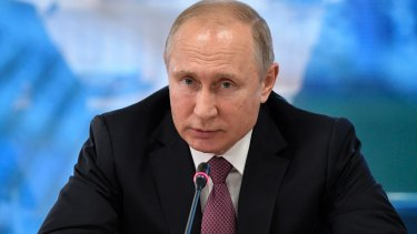 Russian President Vladimir is wrecking Western democracy according to history Timothy Snyder's latest book.