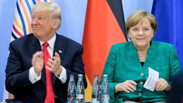 Donald Trump and German Chancellor Angela Merkel on the second day of the G20.