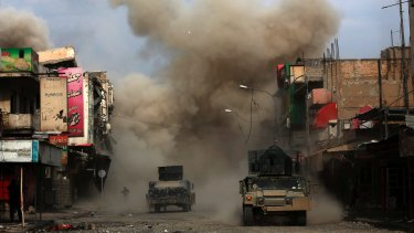 Three roadside bombs laid by Islamic State group militants explode in western Mosul.
