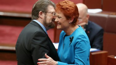In happier times: Senator Hanson is congratulated by Senator Hinch after last year's election.