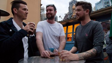 Corey Wakefield, Mike Harding and  Daniel Langton have a drink after work.