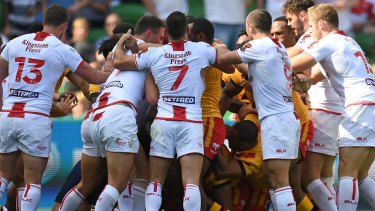 Push and shove: England and Papua New Guinea players clash.