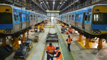 Workers at Downer's Newport workshop, where high-capacity trains will be built.
