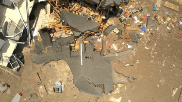Debris is strewn about after a sinkhole damaged two homes in Land O' Lakes, Florida.