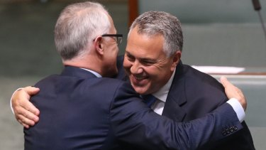 Prime Minister Malcolm Turnbull embraces former treasurer Joe Hockey after Mr Hockey's  valedictory speech.