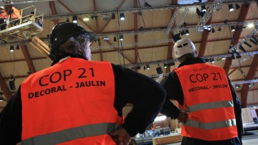 Work goes ahead in the hall that will welcome the COP21 climate summit north of Paris.