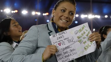 An Australian athlete holds up a sign as the Australia team arrive during the opening ceremony for the 2016 Summer Olympics in Rio de Janeiro, Brazil.