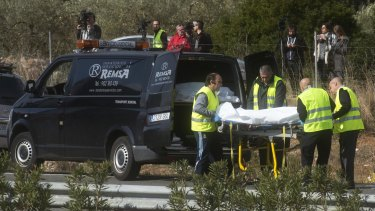 The aftermath of the accident involving a bus and a car in Spain.