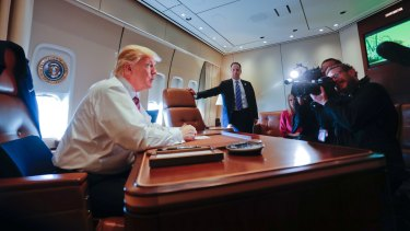 President Donald Trump at his desk on Air Force One on Thursday.
