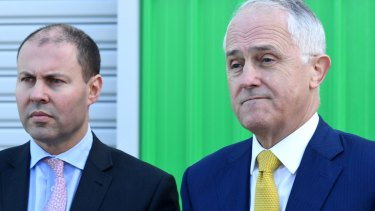 Malcolm Turnbull with Josh Frydenberg who is seeking answers over possible Hungarian citizenship.