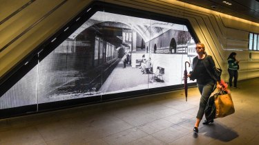 An electronic screen features archival photographs of Wynyard Station.