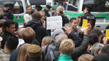 Syrian refugees are welcomed on arrival in Munich.