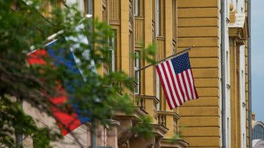 US and Russian flags hung at the US Embassy in Moscow, Russia.