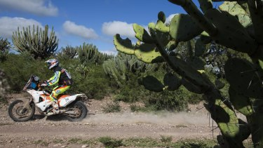 In charge: KTM rider Toby Price of Australia races between the cities of Termas de Rio Hondo and Rosario, Argentina in the Dakar Rally.