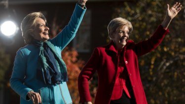 Early advantage: Democratic presidential candidate Hillary Clinton (L) at a rally in New Hampshire with Senator Elizabeth Warren.
