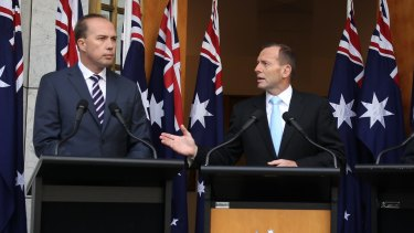 Immigration Minister Peter Dutton and Prime Minister Tony Abbott address the media on Tuesday.