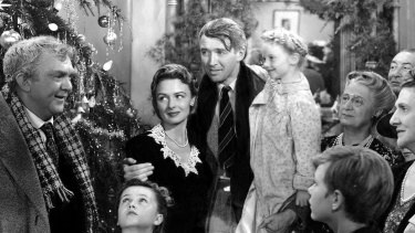 Thomas Mitchell, left, Donna Reed and James Stewart, centre, in a scene from  <i>It's A Wonderful Life</i>.
