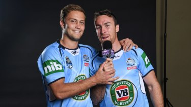 Trading places: Matt Moylan and James Maloney.